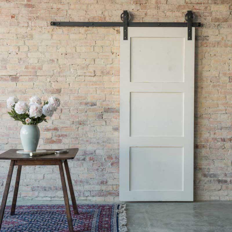 Porte coulissante en applique style grange