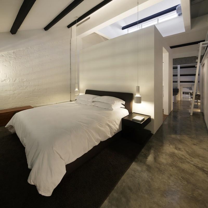Chambre avec béton ciré gris