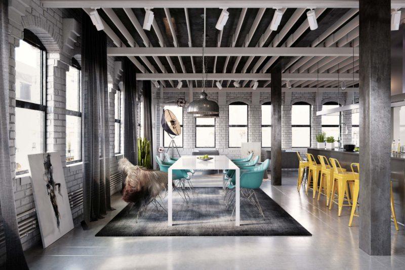 Loft avec béton ciré gris et murs en briques blanches