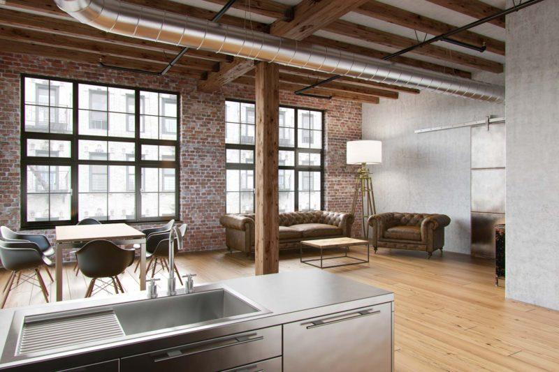 Loft avec poutre bois au plafond