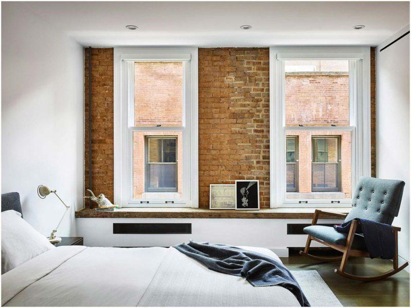 Chambre avec mur en briques