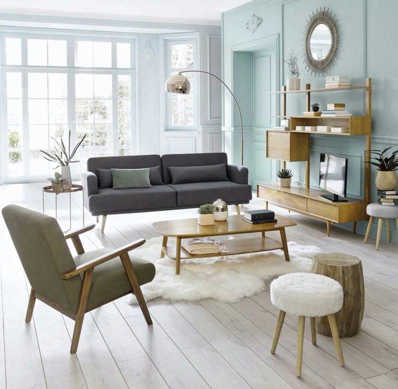 Canapé convertible scandinave dans un salon style vintage