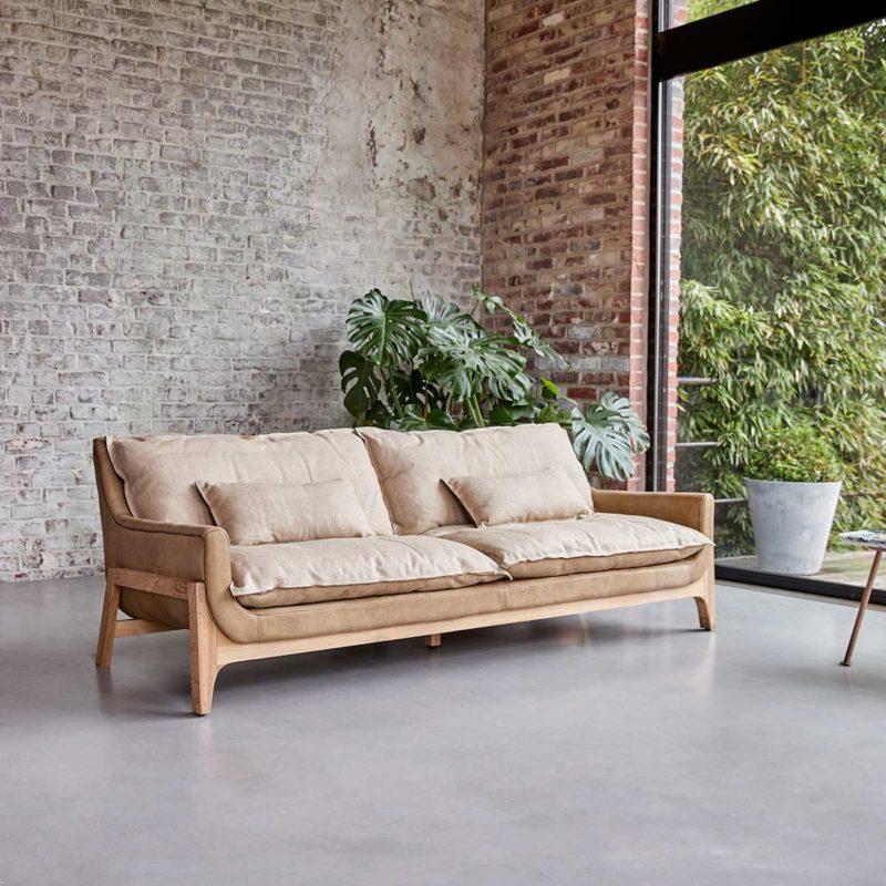 Canapé trois places en cuir et lin
