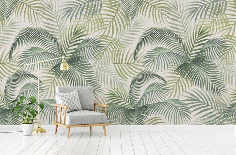 Salon avec papier peint à motifs verts