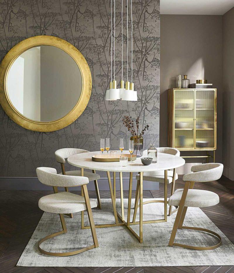 Table à manger avec plateau marbre et pieds dorés